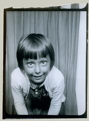 Photobooth girl leaning forward