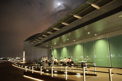 People chilling at the Haneda Airport observation deck at night