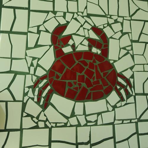 Red crab mosaic, white tile background, concrete, Sam's Crab Shack, women's bathroom art, Schaumburg, Illinois, USA by Wonderlane