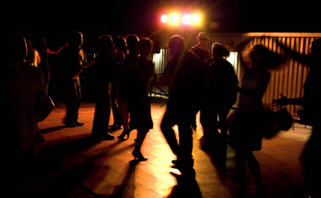 silhouettes of people salsa dancing