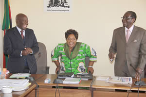 President Mugabe and Vice President Joice Mujuru share a lighter moment with Zanu-PF secretary for administration Cde Didymus Mutasa, who turned 77 July 27, 2012 before the extra-ordinary session of the Politburo. by Pan-African News Wire File Photos