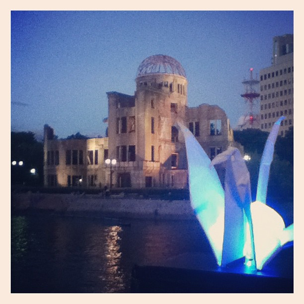 Glowing origami cranes and the a-bomb dome in Hiroshima.