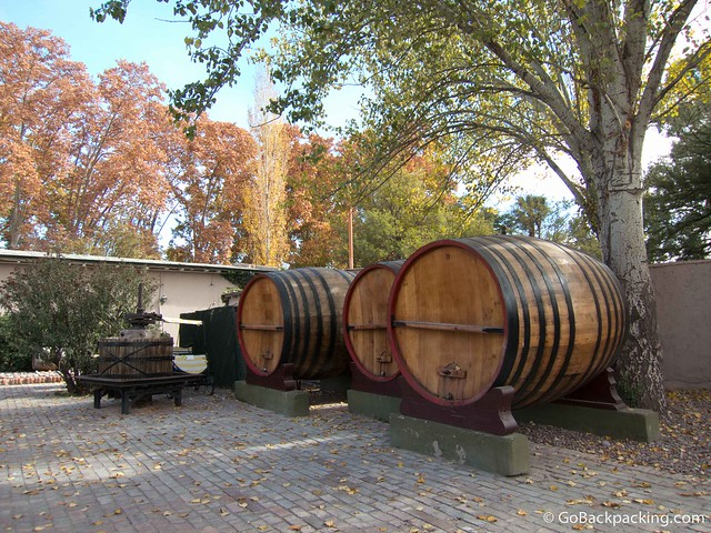Old barrels decorate the property of a winery