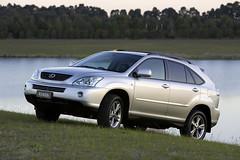 lexus rx hybrid(0.0), automobile(1.0), automotive exterior(1.0), sport utility vehicle(1.0), wheel(1.0), vehicle(1.0), lexus rx(1.0), compact sport utility vehicle(1.0), lexus(1.0), crossover suv(1.0), bumper(1.0), land vehicle(1.0),