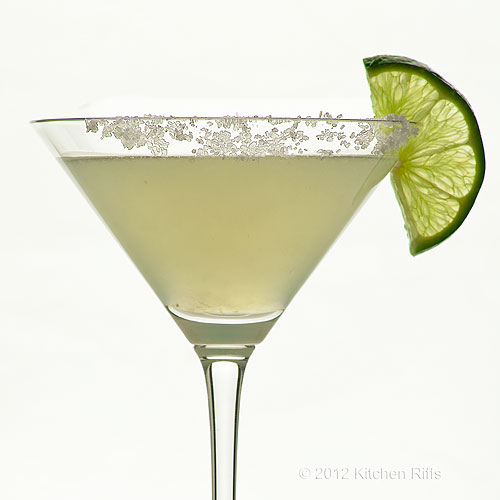 Classic Margarita Cocktail in Cocktail Glass with Salted Rim and Lime Slice