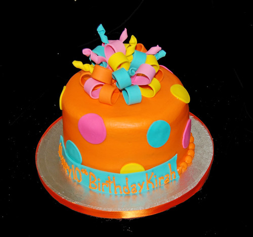 orange pink yellow and aqua 10th birthday cake