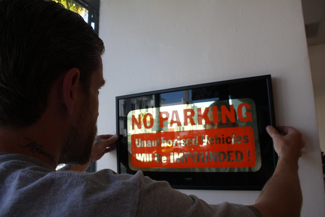 NO PARKING, one of Sean Barton's 22kt gold signs