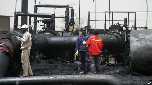 Sudanese oil workers inspect burnt out equipment at the field in Heglig on the border with the South. The conflict with the Republic of Sudan has further crippled the South Sudanese economy. by Pan-African News Wire File Photos