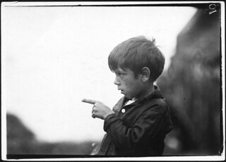 """""""I nearly cut my finger off, cutting sardines the other day."""" 7 year old Byron. Eastport, Me, August 1911"""
