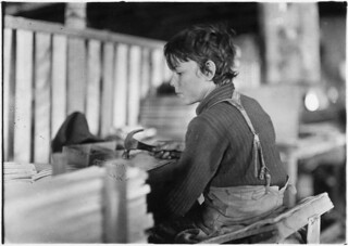 Boys making melon baskets. A basket factory. Evansville, Ind, October 1908
