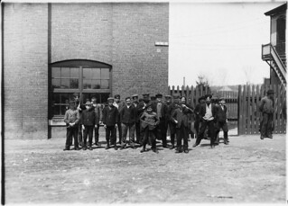 Noon hour at the Queen City Mill. About a dozen small boys like the smallest here. Names of small ones are Dorio Charptier, Arthur Tessier. Burlington, Vt, May 1909