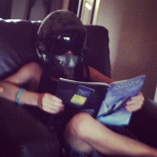 Ace chillaxing in his uncle's flight mask. Because you never know when you might lose cabin pressure in the living room