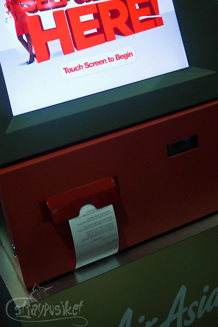 Printed boarding pass at Air Asia Self Check In Kiosk