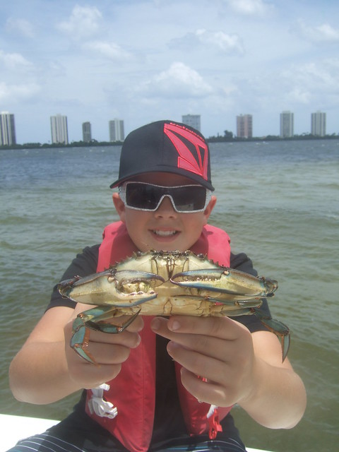 Casey holds a BIG blue crab.