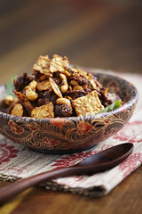 produce(0.0), breakfast cereal(1.0), meal(1.0), breakfast(1.0), food(1.0), dish(1.0), dessert(1.0), muesli(1.0), cereal(1.0), cuisine(1.0), snack food(1.0),