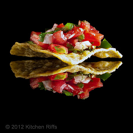 Salsa on Tortilla Chip on Black Acrylic