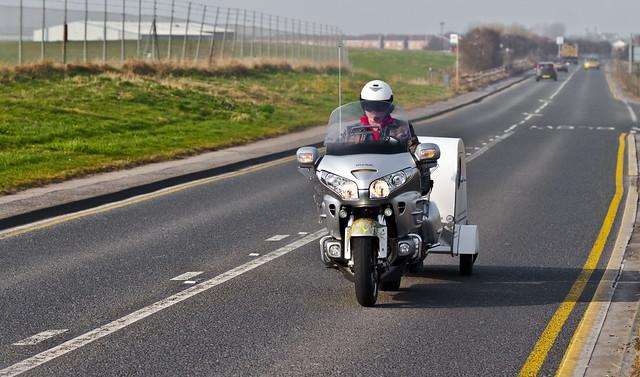 Motorcycle towing Caravan.