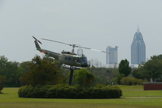 Skyline of mobile over Bell UH-1H Huey