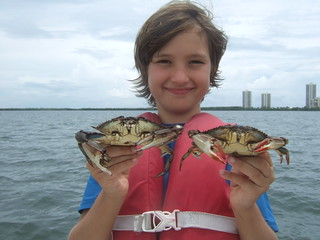 Beau with some big blue crabs.