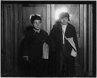 In a saloon doorway at 8:30 P.M. Left to right, George Cappello, 12 years old. Frank Laporter, 13 years old. Utica, N.Y., February 1910