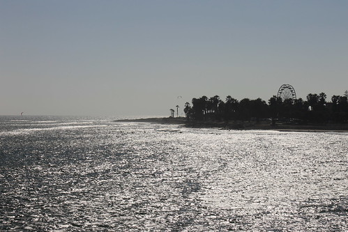 Sun sparkles from Ventura Pier, looking toward fairground