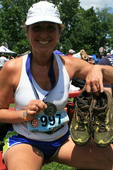 50k medal and mud shoes