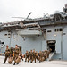 New Zealand Army soldiers assigned to Alpha Company disembark USS Essex.