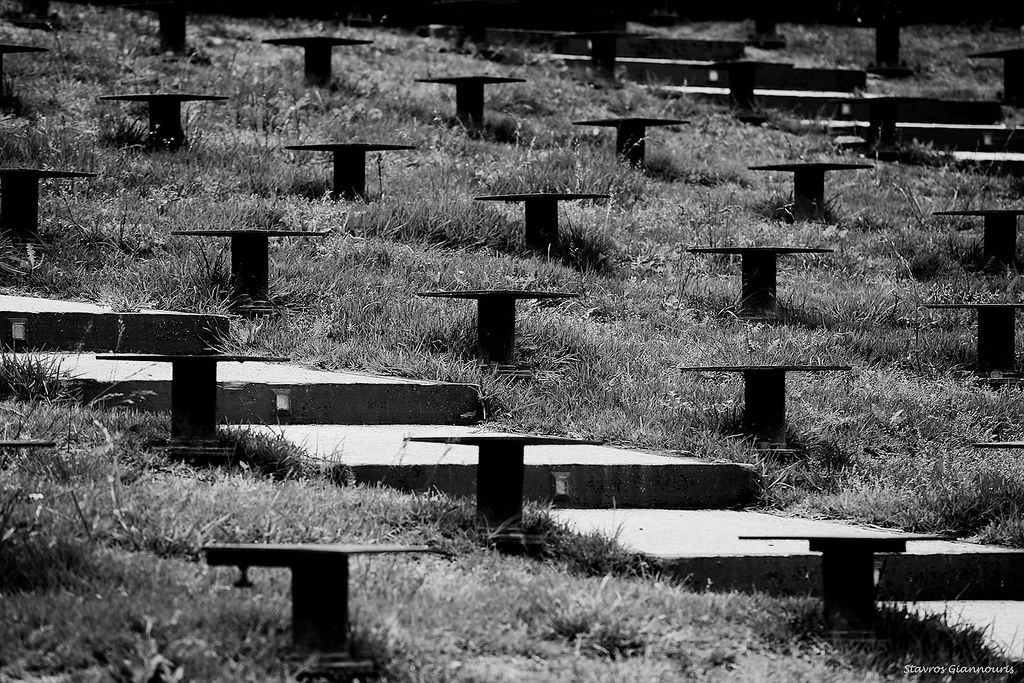 """The bench legs at the Medieval Moat Theater \""Melina Merkouri\"" in Rhodes Old Town in B&W"""