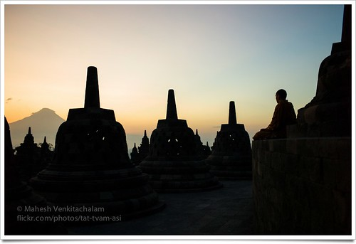 Meditating monk at sunrise on top of Borobudur Temple, Java