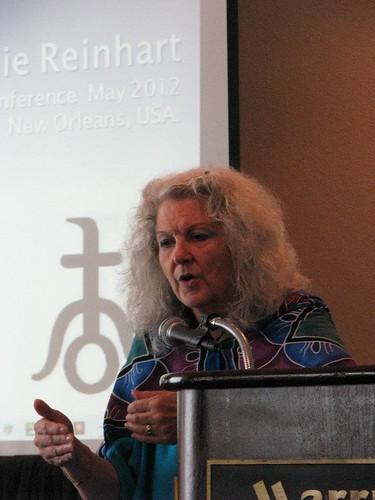 Melanie Reinhart Speaking by Postcards from UAC