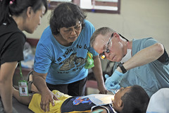 NORTH SULAWESI (June 8, 2012) Dr. Stuart Whiddon, from the Free Dental Society, prepares six year-old patient Aldi Lakada for oral treatment during a Medical Civic Action Project(MEDCAP) during Pacific Partnership 2012. (U.S. Navy photo by Mass Communication Specialist 2nd Class Roadell Hickman)