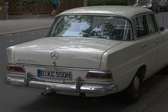 automobile(1.0), automotive exterior(1.0), executive car(1.0), family car(1.0), vehicle(1.0), mercedes-benz w108(1.0), mercedes-benz(1.0), compact car(1.0), mercedes-benz w111(1.0), antique car(1.0), sedan(1.0), classic car(1.0), land vehicle(1.0), luxury vehicle(1.0),