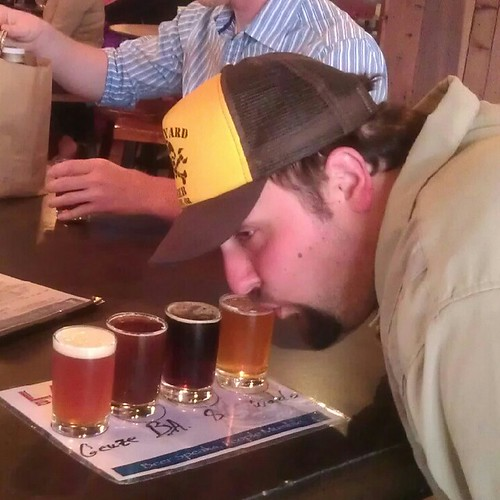 "Theo ""Broma"" Skourtist getting down with a sampler tray at Lagunitas"