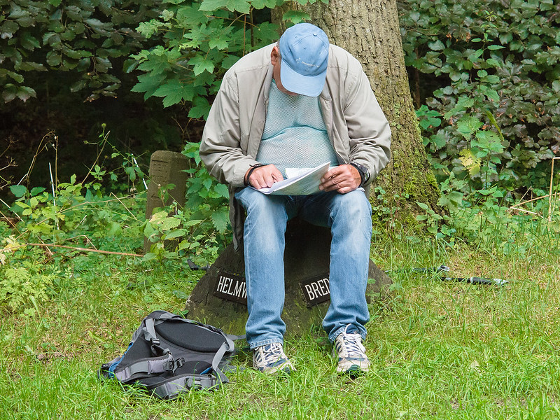 Male Hiker Studying A Map While Resting