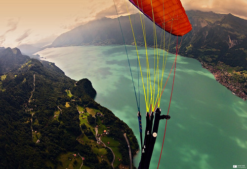 wood sky mountains alps water beautiful clouds forest switzerland village view brienz brienzersee hills paragliding glider advance paraglider 2012 berneseoberland lakebrienz cantonofbern danielwildiphotography