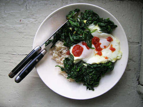 rice bowl with fried eggs and spinach