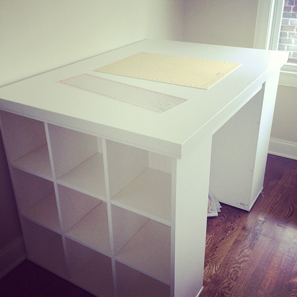 OMG! I am in love!!!!!!! New cutting table and fabric storage!