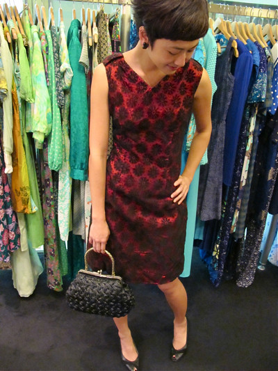Gorgeous 1960s lace daisy dress in a deep shade of burgundy! Size M/L. Matched with a 1960s black straw bag.