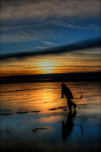 blue light sunset sun reflection hockey minnesota silhouette yellow north reflect skate stick