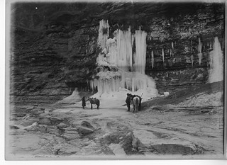 China, Miscellaneous Scenes: Arthur de Sowerby and another man in front of frozen waterfall on sandstone strata near Quinjian, Shaanxi