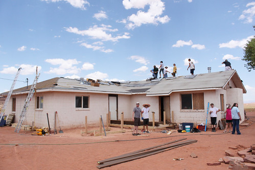 Two groups of volunteers worked to replace the roof