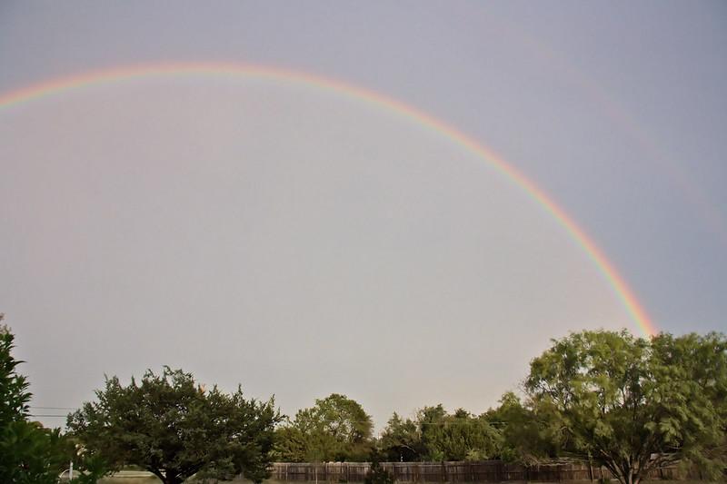 Lightning, rainbow, and sunset.