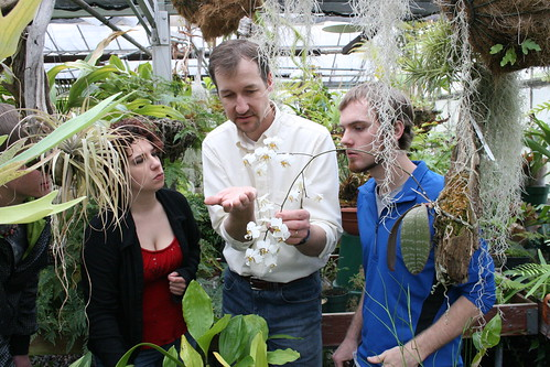 Botany students with professor in greenhouse