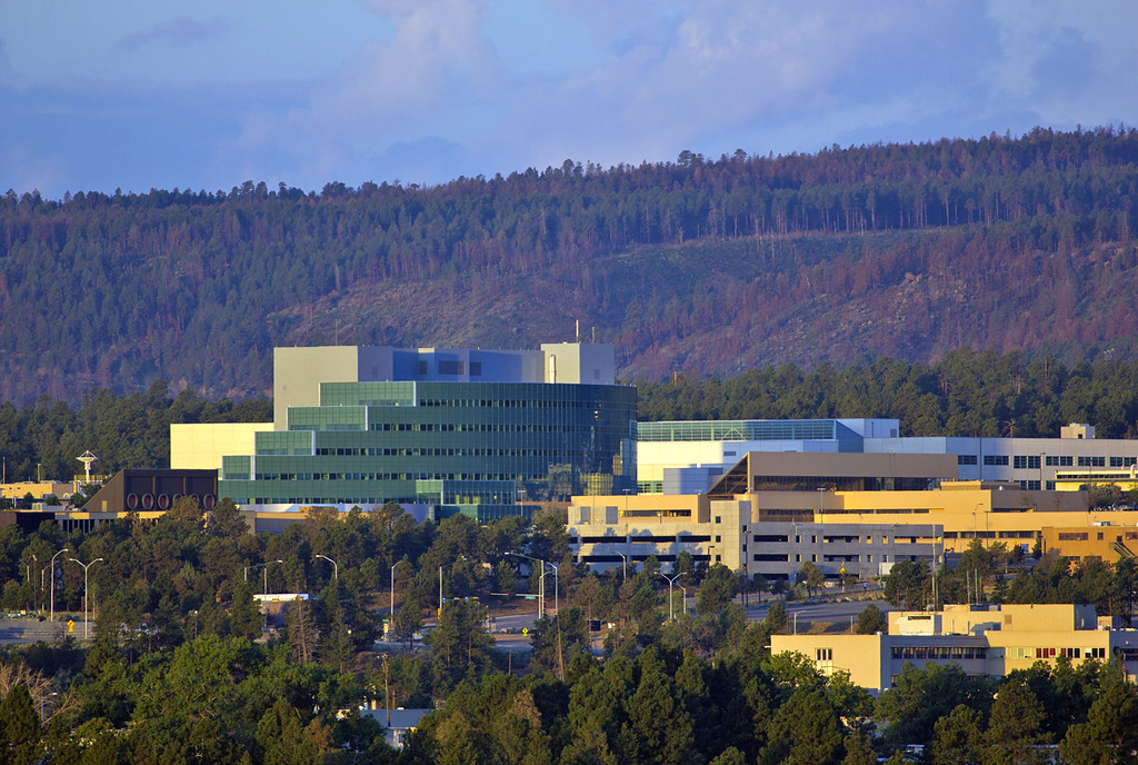 Los Alamos National Laboratory sits on top of a once-remote mesa in northern New Mexico with the Jemez mountains as a backdrop to research and innovation covering multi-disciplines from bioscience, sustainable energy sources, to plasma physics and new materials.