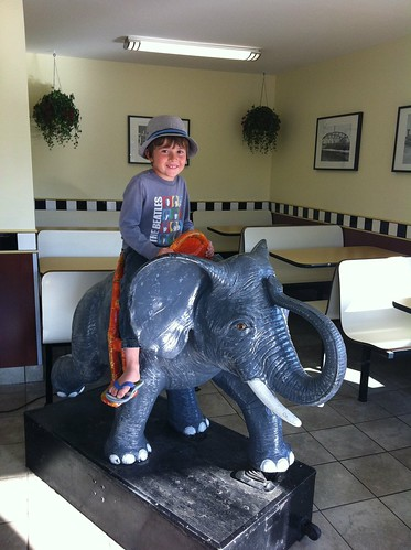 Evan riding the cool retro elephant at Inglewood Drive-In