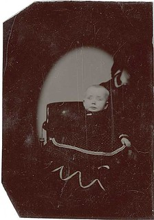 Vignetted Tintype of a Terrified Baby and a Hidden Mother