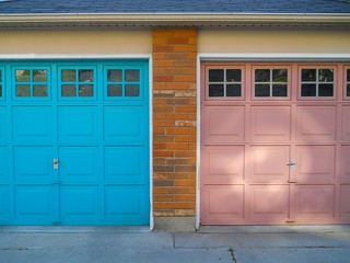 twin garage doors, one pink one blue, may 2012