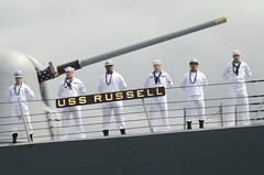PEARL HARBOR (April 23, 2012) USS Russell (DDG 59) crew members man the rails as the ship arrives at Joint Base Pearl Harbor-Hickam. (U.S. Navy photo by Mass Communication Specialist 2nd Class (SW) Mark Logico)