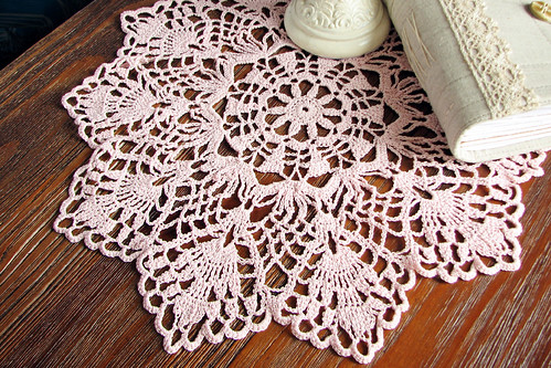 crocheted doily in pink
