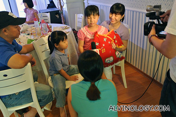 Two sisters getting interviewed by omy.sg on their pillow creations